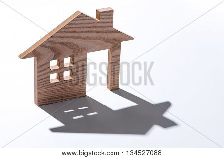 Wooden House Shaped. Model of the house on white background