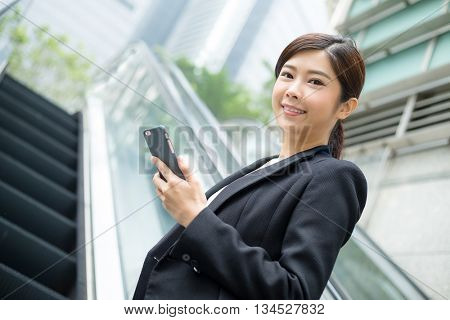 Asian Business woman holding a cellphone