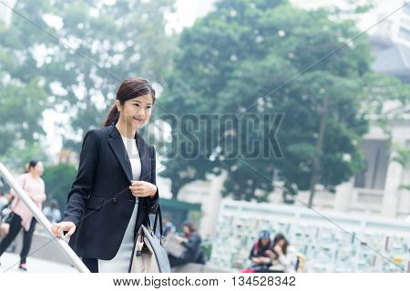 Business woman walking down the stair