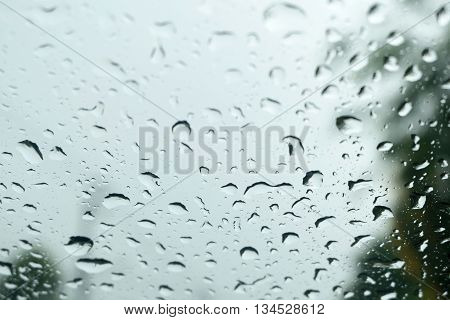Rain drops on a car window, Water drop on glass mirror abstract background