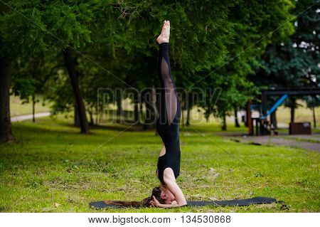 Fitness Woman On Head - Young Attractive Girl Doing The Headstand.