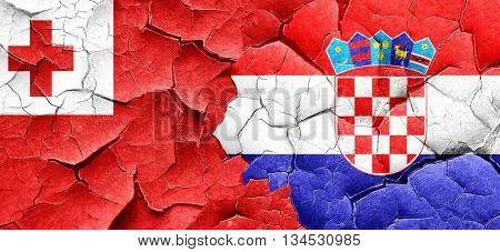 Tonga flag with Croatia flag on a grunge cracked wall