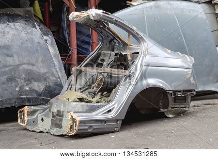 Gas cut used car body for using as second hand spare parts in garage