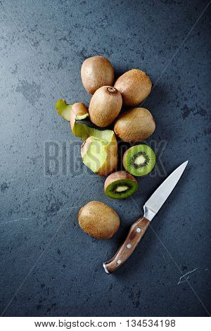 An Arrangement of Kiwi Fruits on a Black Stone
