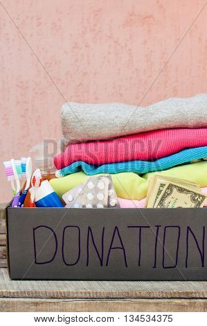 Donation box with clothes, living essentials and money