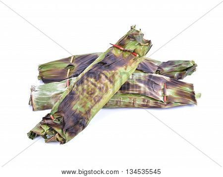 Sticky Rice with Coconut Milk and Taro in banana leaf on white background (Thai dessert)