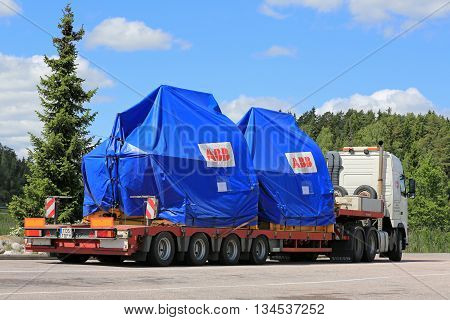 PAIMIO, FINLAND - JUNE 12, 2016: Volvo FH truck is ready to transport two industrial objects on trailer as oversize load in South of Finland.
