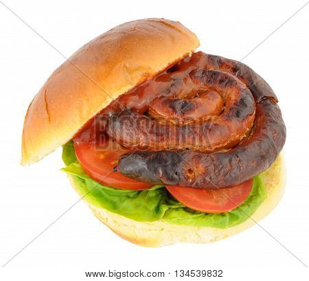 Curly pork sausage sandwich with lettuce and tomato in a bread bun isolated on a white background
