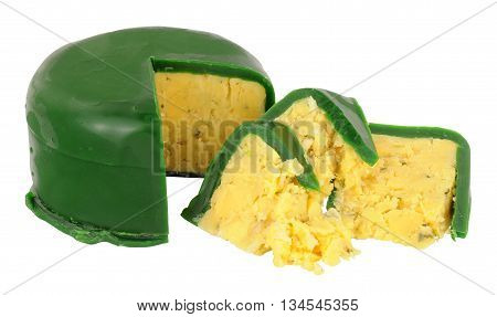 Green wax covered double Gloucester cheese isolated on a white background