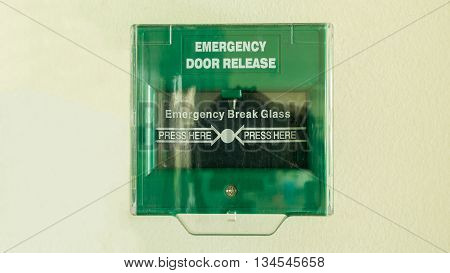 Emergency door release to escape from the room for safety by breaking glass