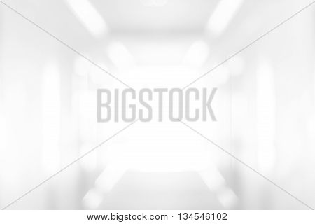 Abstract blur white room or corridor with light at the end wall - use for background or backdrop for your design element