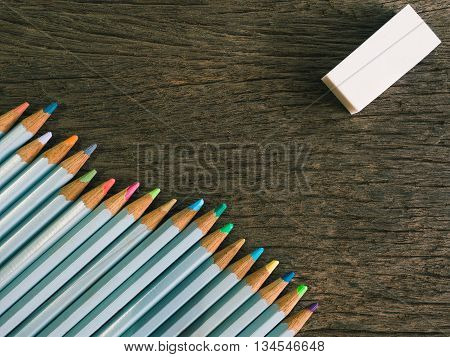 Colorful Pencil And Rubber Arrange On The Wooden Table Symbolized To Be A Forgiveness,resolving