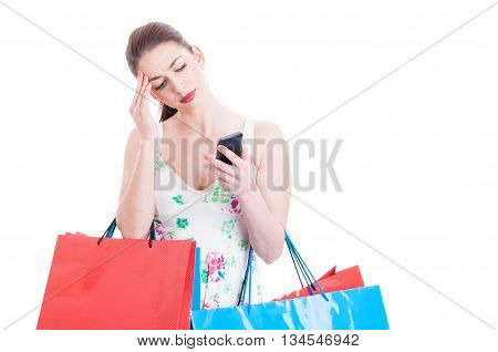 Beautiful Lady Shopper Looking At Phone And Feeling Confused