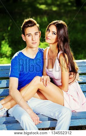 Romantic young couple in love having a rest together in the park. Romantic summer day.