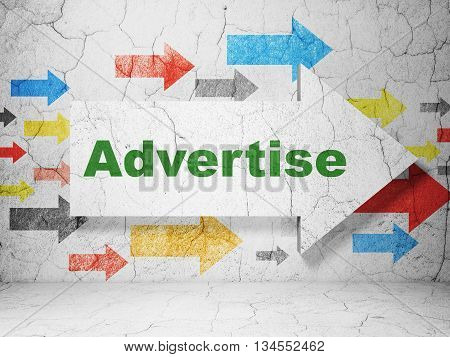 Advertising concept:  arrow with Advertise on grunge textured concrete wall background, 3D rendering
