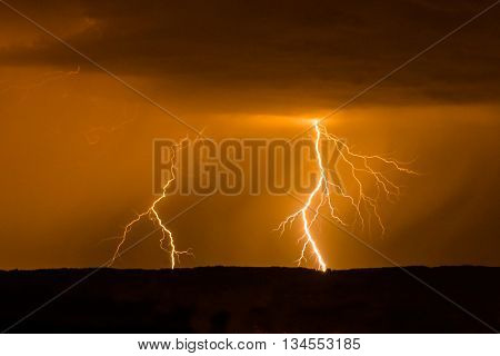 Double lightning in red sky during stormy weather