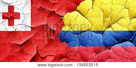 Tonga flag with Colombia flag on a grunge cracked wall