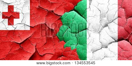 Tonga flag with Italy flag on a grunge cracked wall