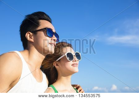closeup Happy young Couple face with cloud background