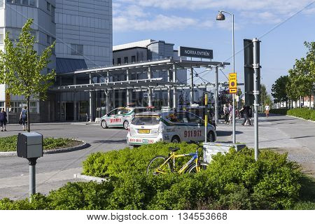 UMEA, SWEDEN ON JUNE 02. View of the Entry North to the Region Hospital, NUS in the morning on June 02, 2016 in Umea, Sweden. Taxi cabs, people by the entry. Editorial use.