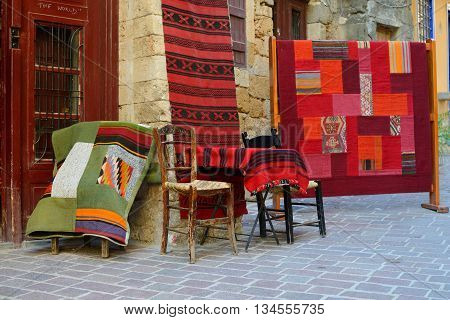 CHANIA GREECE - AUGUST 07: Traditional carpets for sale in Chania Greece on August 07 2014. Chania is one of the most popular tourist place on Crete island in Greece.