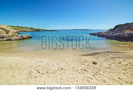small cove in Alghero shoreline in Italy