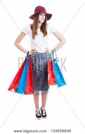 Young Shopper Wearing Trendy Outfit And Posing With Shopping Bags