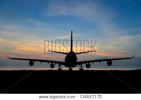Silhouette of passenger aircraft airline on beautiful sunset background