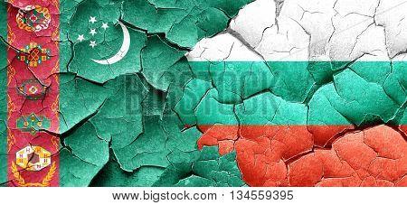 Turkmenistan flag with Bulgaria flag on a grunge cracked wall