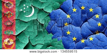 Turkmenistan flag with european union flag on a grunge cracked w