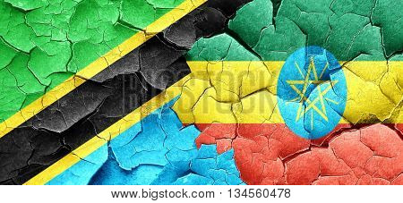 Tanzanian flag with Ethiopia flag on a grunge cracked wall