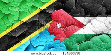 Tanzanian flag with Jordan flag on a grunge cracked wall