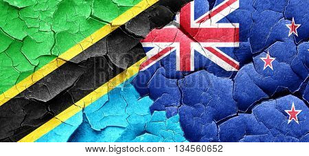 Tanzanian flag with New Zealand flag on a grunge cracked wall