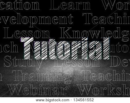 Education concept: Glowing text Tutorial in grunge dark room with Dirty Floor, black background with  Tag Cloud
