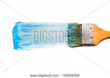 paint brush and blue dab of toothpaste. blue tooth paste. texture. sample and brush isolated on white background