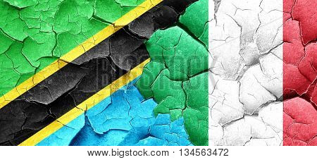 Tanzanian flag with Italy flag on a grunge cracked wall