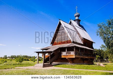 View Of Wooden Church Of St. Nicholas In Ancient Suzdal Kremlin. Suzdal Town Is Part Of Famous Touri