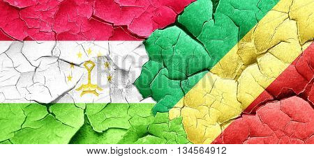 Tajikistan flag with congo flag on a grunge cracked wall