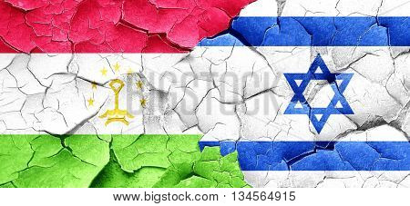 Tajikistan flag with Israel flag on a grunge cracked wall
