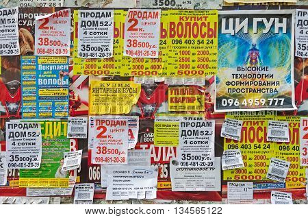 Dnepropetrovsk Ukraine - April 14 2016: Bulletin board with paper detachable coupons to buy sell and exchange