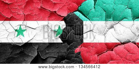 Syria flag with Kuwait flag on a grunge cracked wall