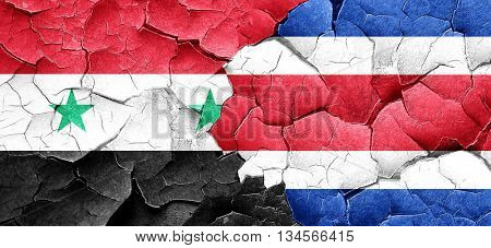 Syria flag with Costa Rica flag on a grunge cracked wall