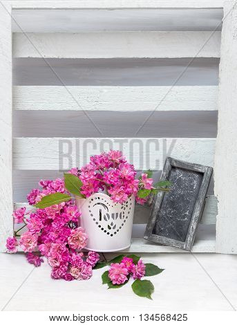 Bouquet Of Small Pink Roses In A White Pot And Plate For Text