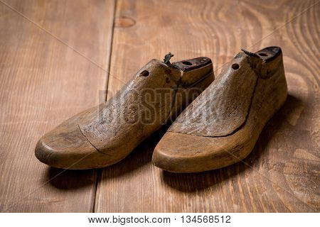 Shoe Lasts On Wooden Background.