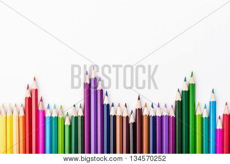 Color pencils pile arrangement on white background