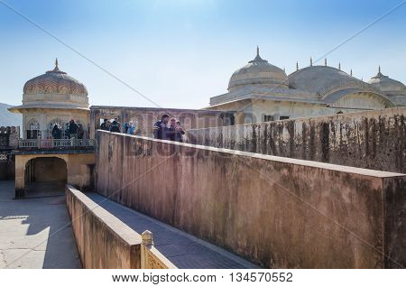 Jaipur India - December 29 2014: Tourists visit Amber Fort in Jaipur Rajasthan India on December 29 2014. The Fort was built by Raja Man Singh I.
