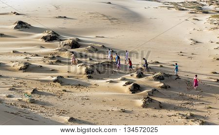 Quang Binh, Vietnam, July 14, 2015 the group of children, waters Quang Binh, central Vietnam, amusement parks and sand dunes