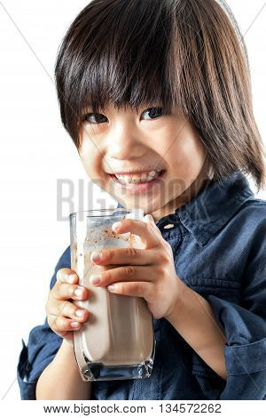 Close up portrait of little Asian boy drinking chocolate milkshake.Isolated on white background.