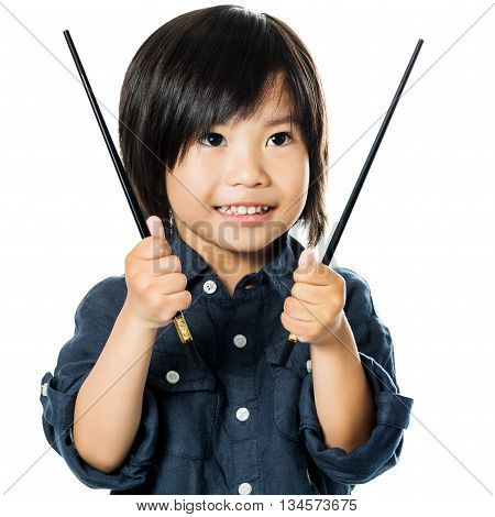 Close up portrait of Little asian boy holding chopsticks.Isolated on white background.