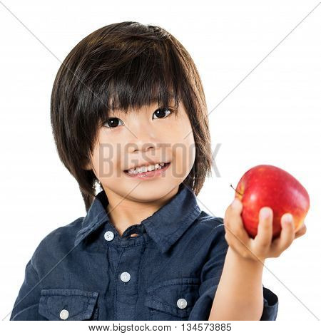 Close up cute asian child showing red apple.Isolated on white background.